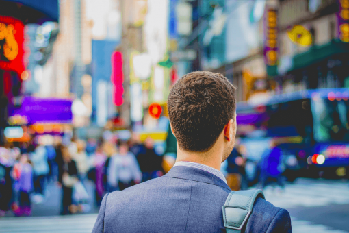 Shallow focus of man on the way to his office