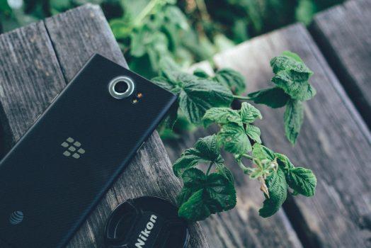 Black Blackberry Priv with Nikon Lens Cover