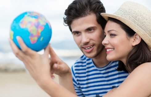 Excited young couple planning their holiday