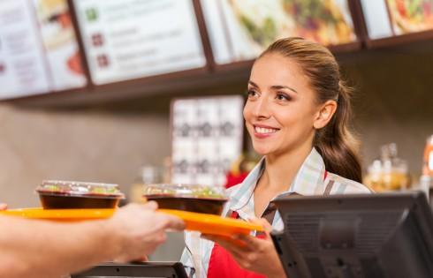 Restaurant worker serving two fast food meals