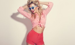 Blonde girl with sunglasses wearing pastel stylization