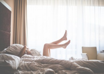 Beautiful Woman Enjoying Morning Relax in Bed
